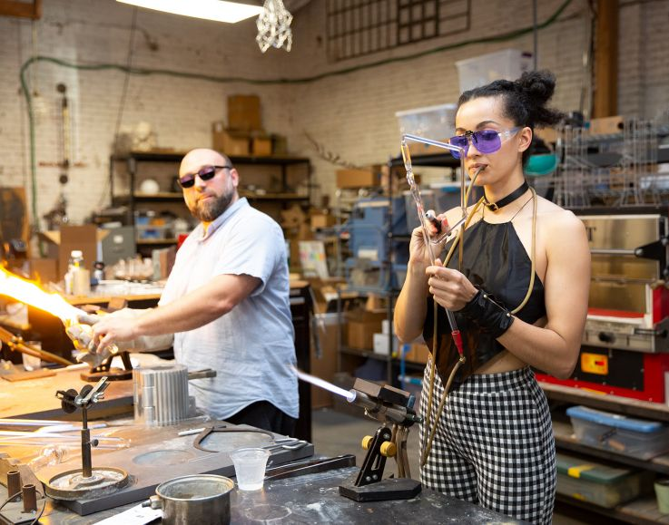 Uri Davillier of Neptune Glassworks and Sibelle Yuksek of Sibelley performing a glass blowing demonstration.
